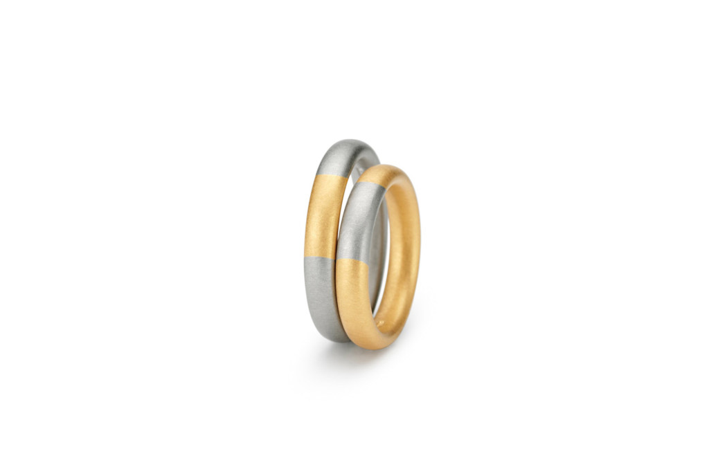 Wedding rings <em>Tecum</em>. 750 gold, 900 gold/950 platinum, 950 platinum/900 gold. Colors: yellow/grey, yellow/white-platinum white, grey/yellow, platinum white/yellow. Price starting at 1.300 Euro.