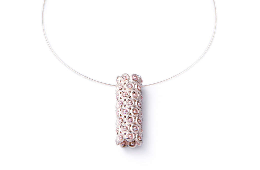 Pearl row pendant. 925 silver, freshwater pearl, stainless steel rope. 580 €.