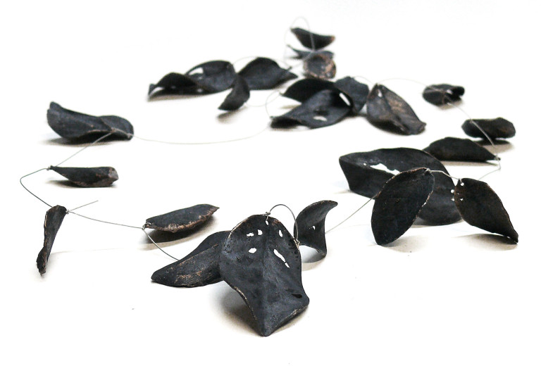 Necklace <em>follage</em>. Bronze oxidised, high-grade steel string. Approx. 90 cm length. 650 Euro.