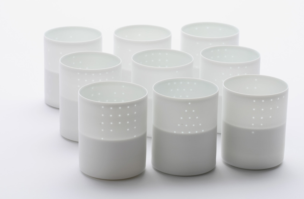 Vessels from the series <em>Light of Dot</em>, 2013. White porcelain, clay, 7.5 × 10.5.
