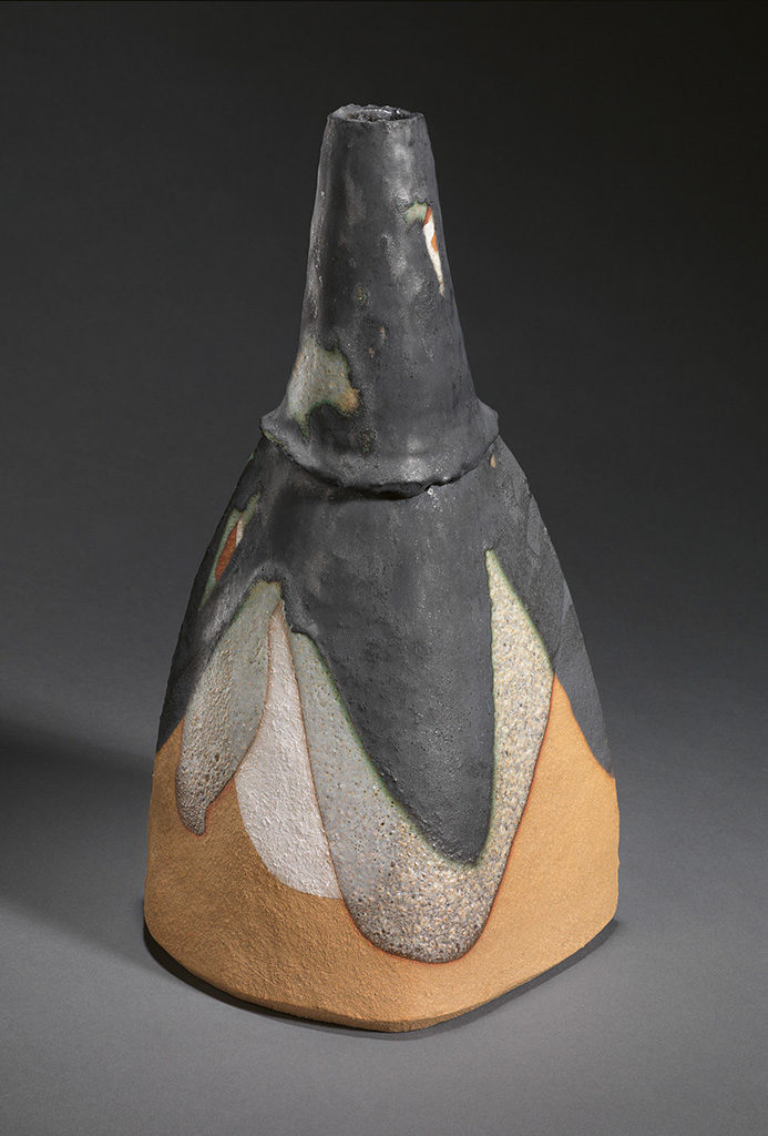 Shape with long neck on asymmetrical triangular base. H 30.2 cm, D 14.5 x 16.8 cm