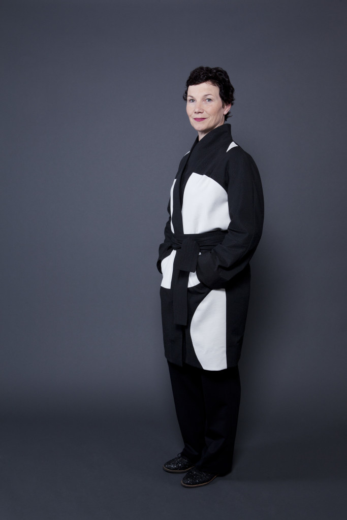 <em>CIRCLEEGG</em> coat. Black, with white circles. 499 €. Photo Miriam Künzli