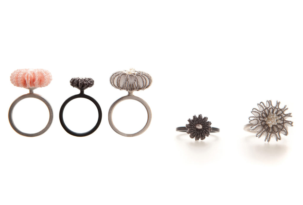 <em>Linea</em> rings medium and small. Silver 925, sweet water beads, nylon, rayon. © Anke Hennig Jewellery
